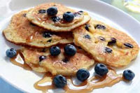 Blueberry and ricotta pancakes with blueberry and ginger sauce